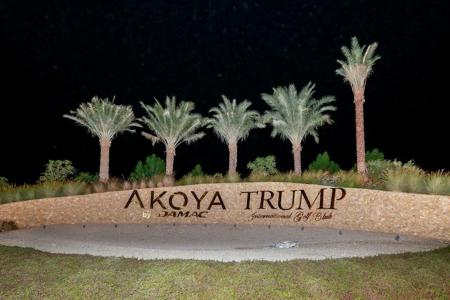 Trump signs in Dubai Back Up