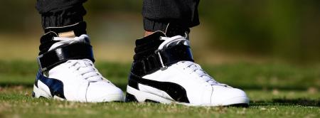 Rickie Fowler wears high tops and tracksuit while playing