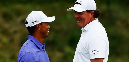 Phil Mickelson celebrates Tiger Woods