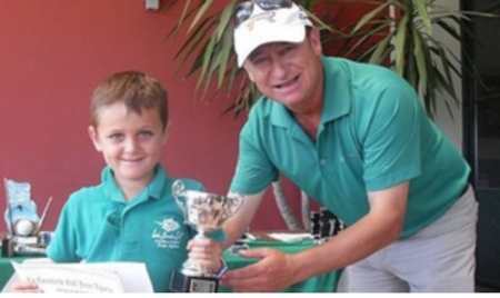 7-year old boy returns golf trophy