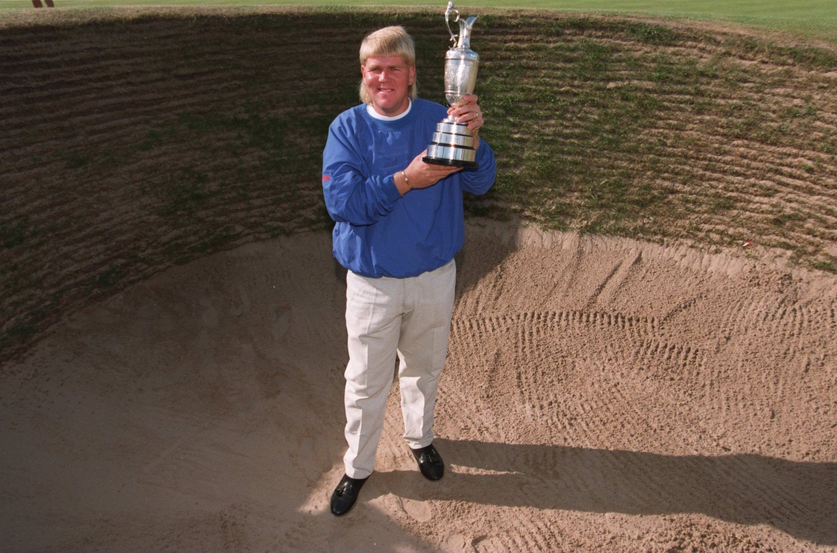 John Daly selling one of his Open replica trophies
