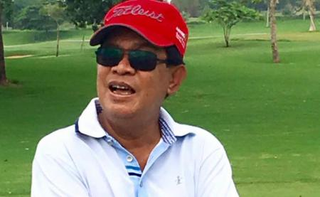 Cambodia's PM complains belly too big to swing a club