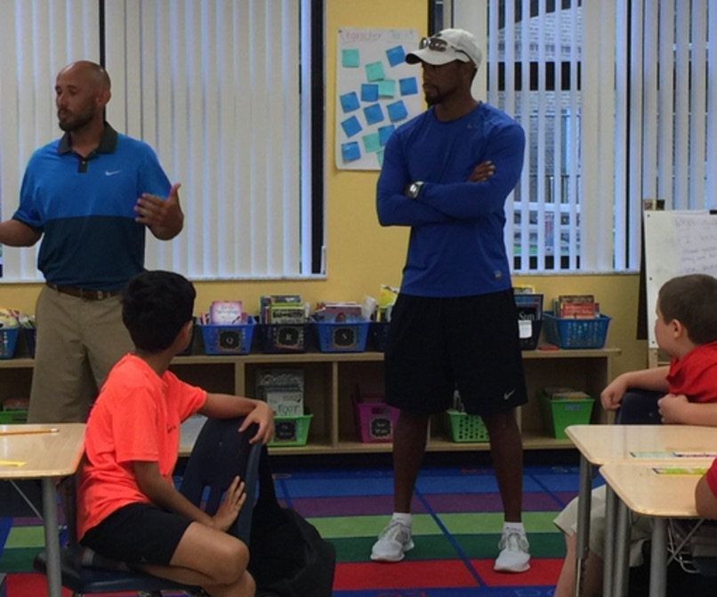 Tiger Woods Goes back to School