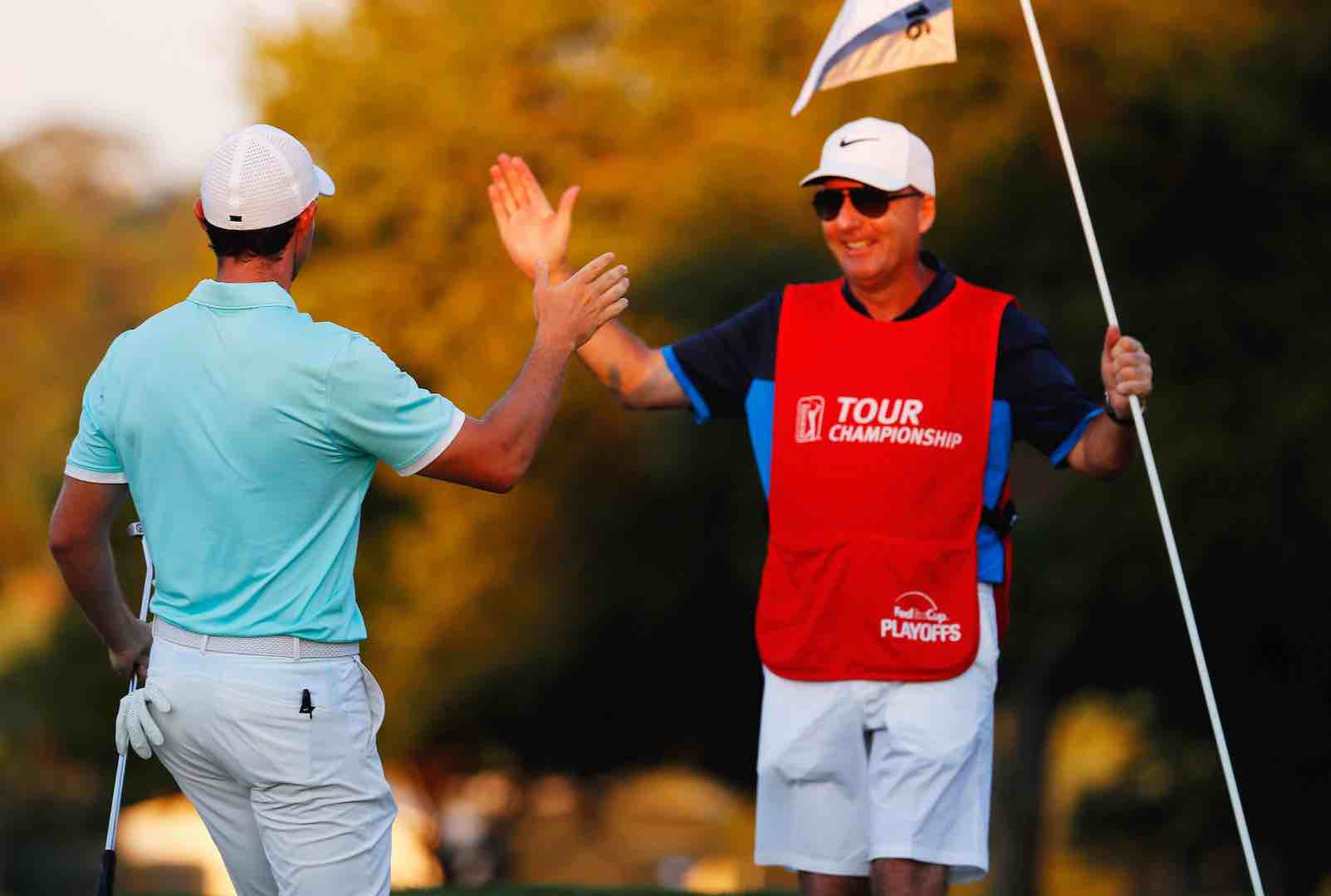 Kerching for Rory's caddie