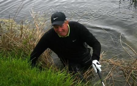 Golfer in water