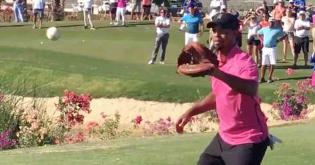 Tiger Woods gets on his baseball glove