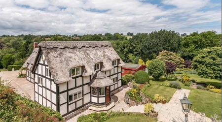 Fancy a cottage with a lovely nine–hole in the garden?