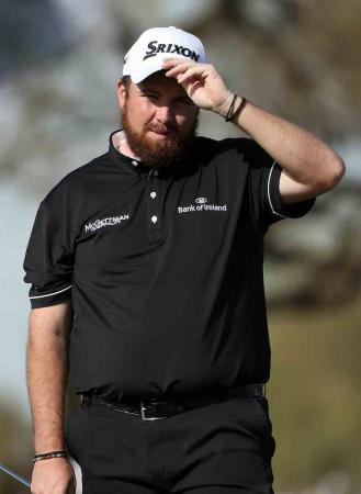 Shane Lowry hands out the Guinness