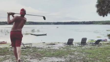 Golfer takes out water–skier