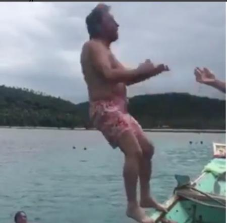 Gary Player does back flip off boat