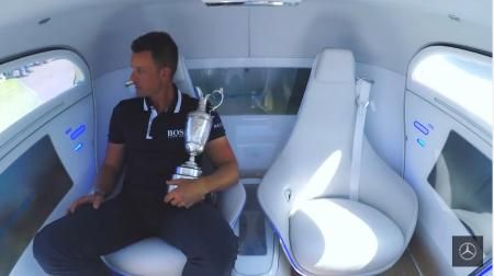Henrik Stenson returns the Claret Jug