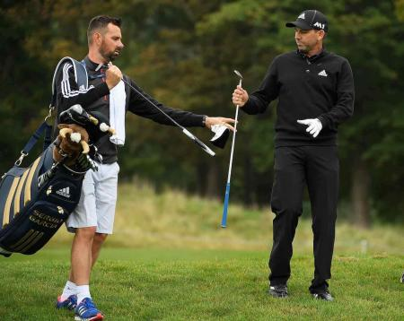 Postman gets his day on Sergio Garcia's bag