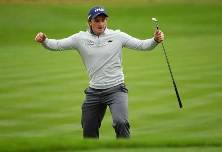 Paul Dunne shoots 61 to win British Masters