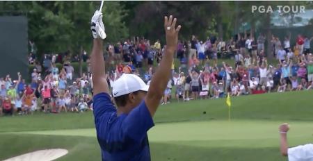 Tiger Woods makes an eagle at Memorial