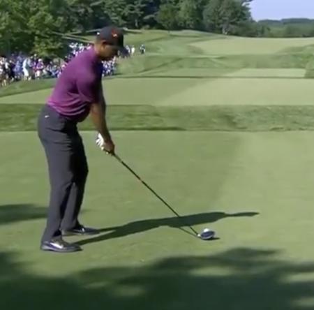 Tiger Woods shoots five under 65