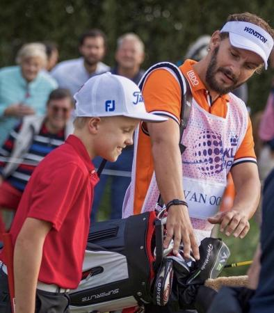 Joost Luiten caddies for nine year old boy