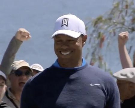 Tiger Woods leads by three