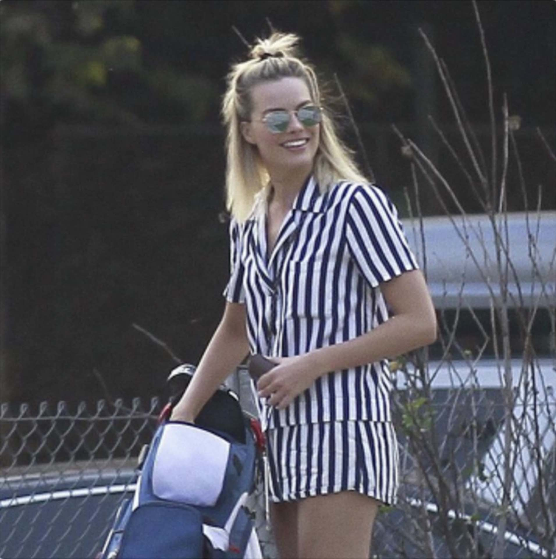 Actress Margot Robbie swings the wrenches